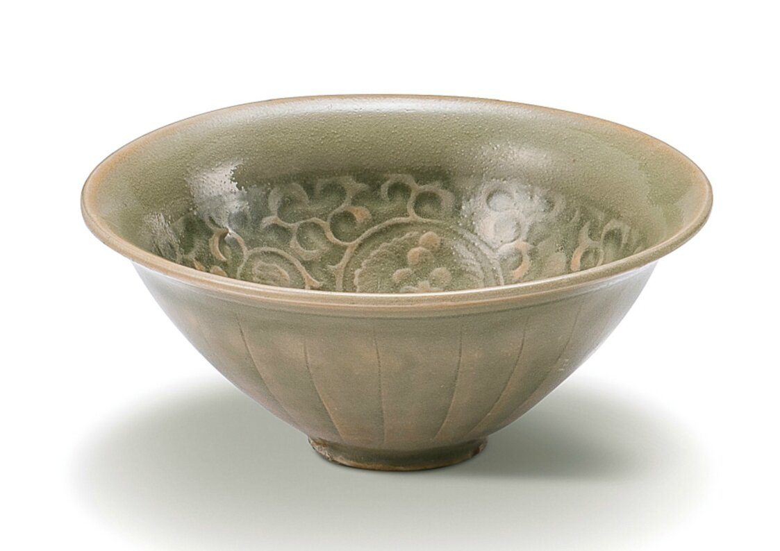 A carved 'Yaozhou' 'floral' bowl, Northern Song dynasty (960-1127)