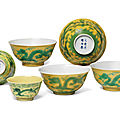 Three near pairs of yellow-ground green-enamelled 'dragon' bowls, two pairs of bowls, guangxu six-character marks and period