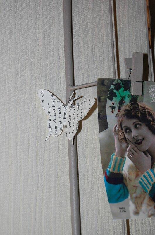 papillon en papier sur pêle-mêle