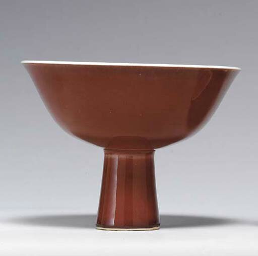 A copper-red-glazed stem bowl, Yongzheng six-character mark in underglaze blue in a line and of the period (1723-1735)