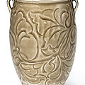 A rare carved Yaozhou celadon 'floral' jar, Northern Song dynasty (960-1127)