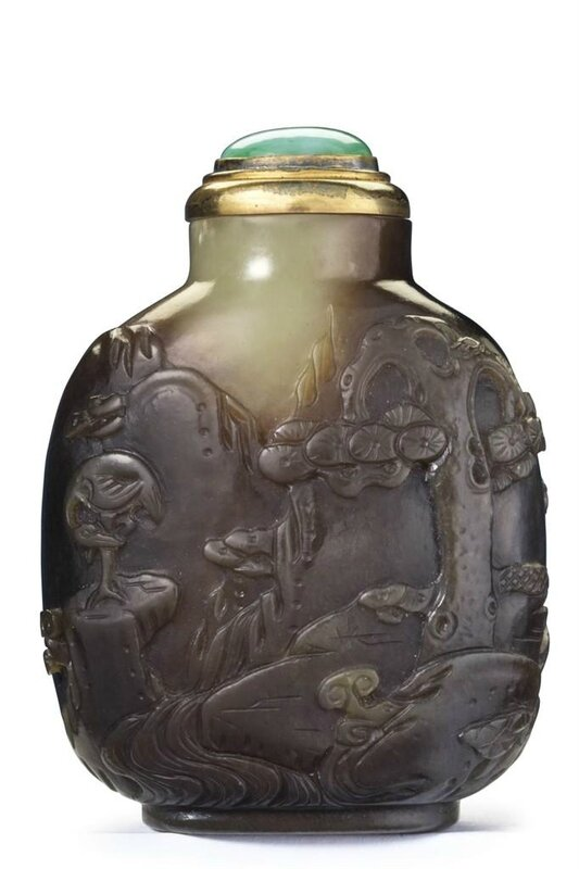 A carved yellowish-green and brown jade snuff bottle, Master of the Rocks School, 1740-1850