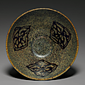 A paper-cut resist-decorated Jizhou bowl, Southern Song dynasty (1127-1279)