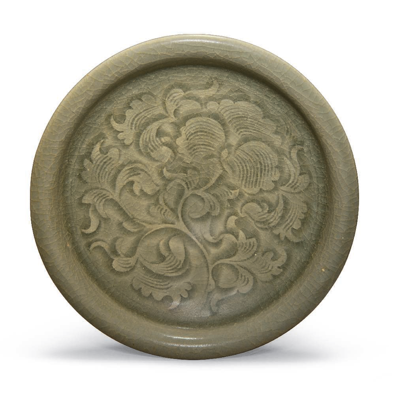 A carved Yaozhou dish, Northern Song-Jin dynasty, 12th-13th century