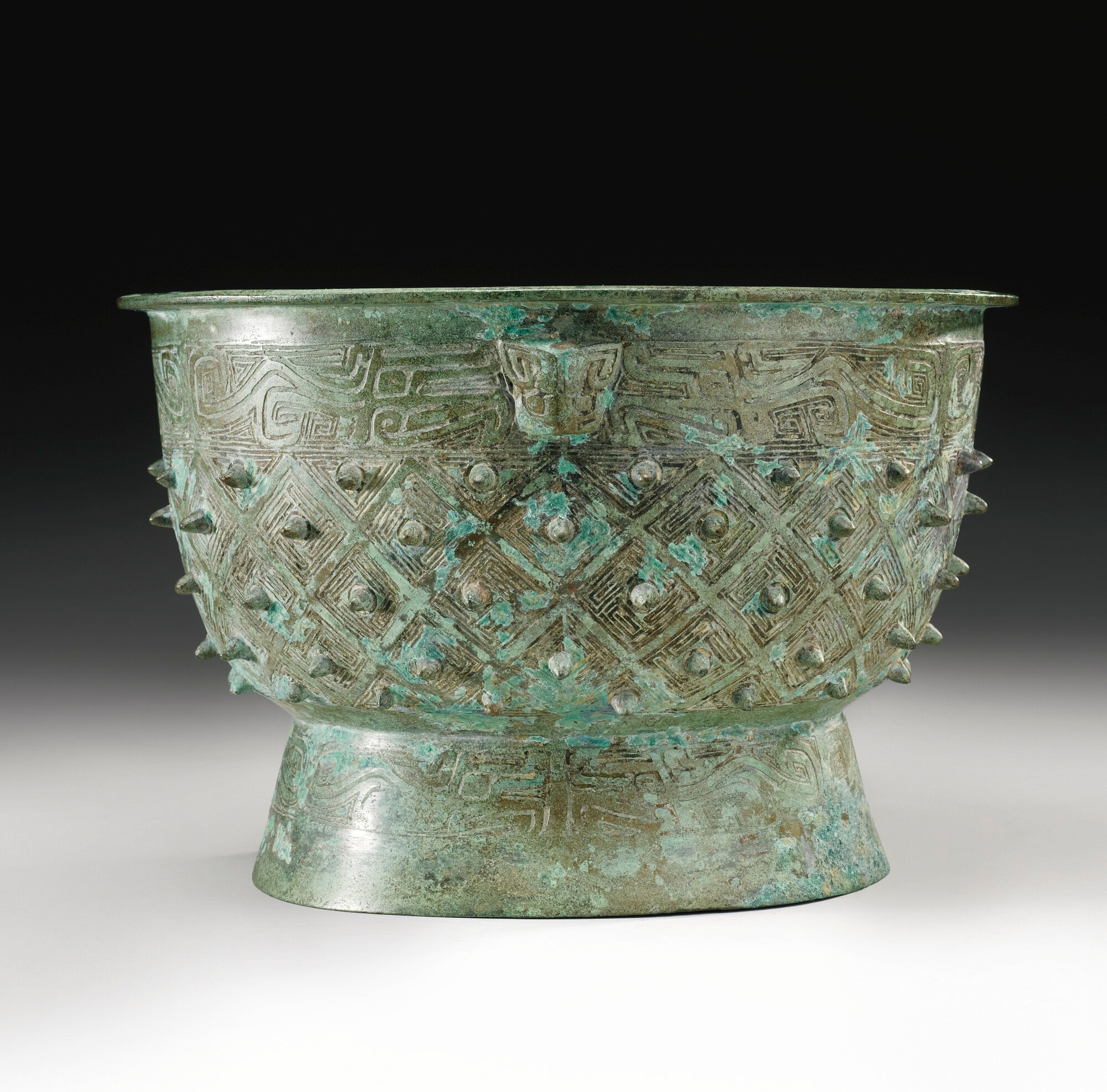 An archaic bronze ritual food vessel, Yu, late Shang dynasty, 13th-11th century BC