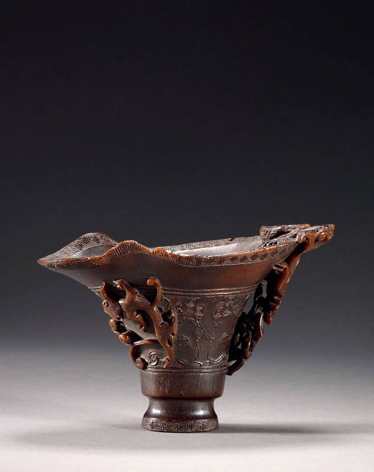 A rare archaistic rhinoceros horn incised libation cup, 17th century