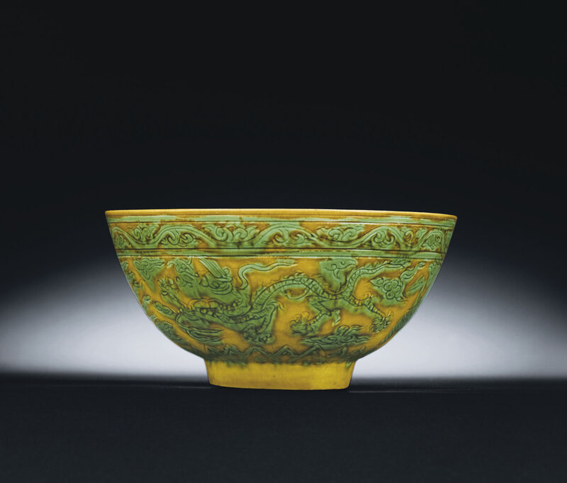 A rare Ming green and yellow incised 'dragon and phoenix' bowl, Jiajing six-character mark and of the period (1522-1566)