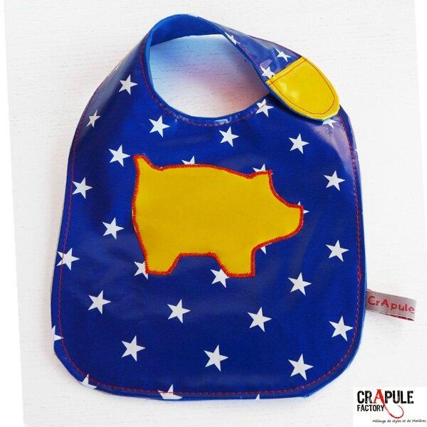 bavoir-scratch-toile ciree bleue etoile et cochon jaune 2600 600-