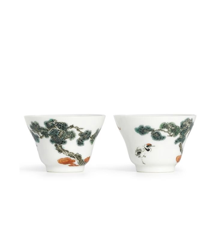 A fine and rare pair of famille-rose 'Crane and pine' cups, Marks and period of Yongzheng