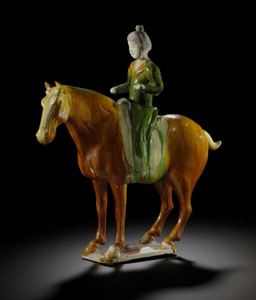 A sancai-glazed pottery figure of a horse and rider, Tang dynasty (618-907)