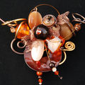collier tour de cou canelle, orange et marron