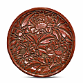 A rare carved cinnabar lacquer 'peony' dish, second half 14th century