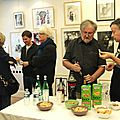 Au premier plan, Jean-Claude et Bernard Mahé, le galeriste