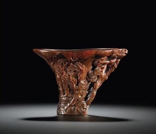 A 'Pine And Mapie' Rhinoceros Horn Libation Cup, Qing Dynasty, Kangxi Period (1662-1722)