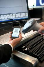 75-Airport-Agent-scanning-mobile-2