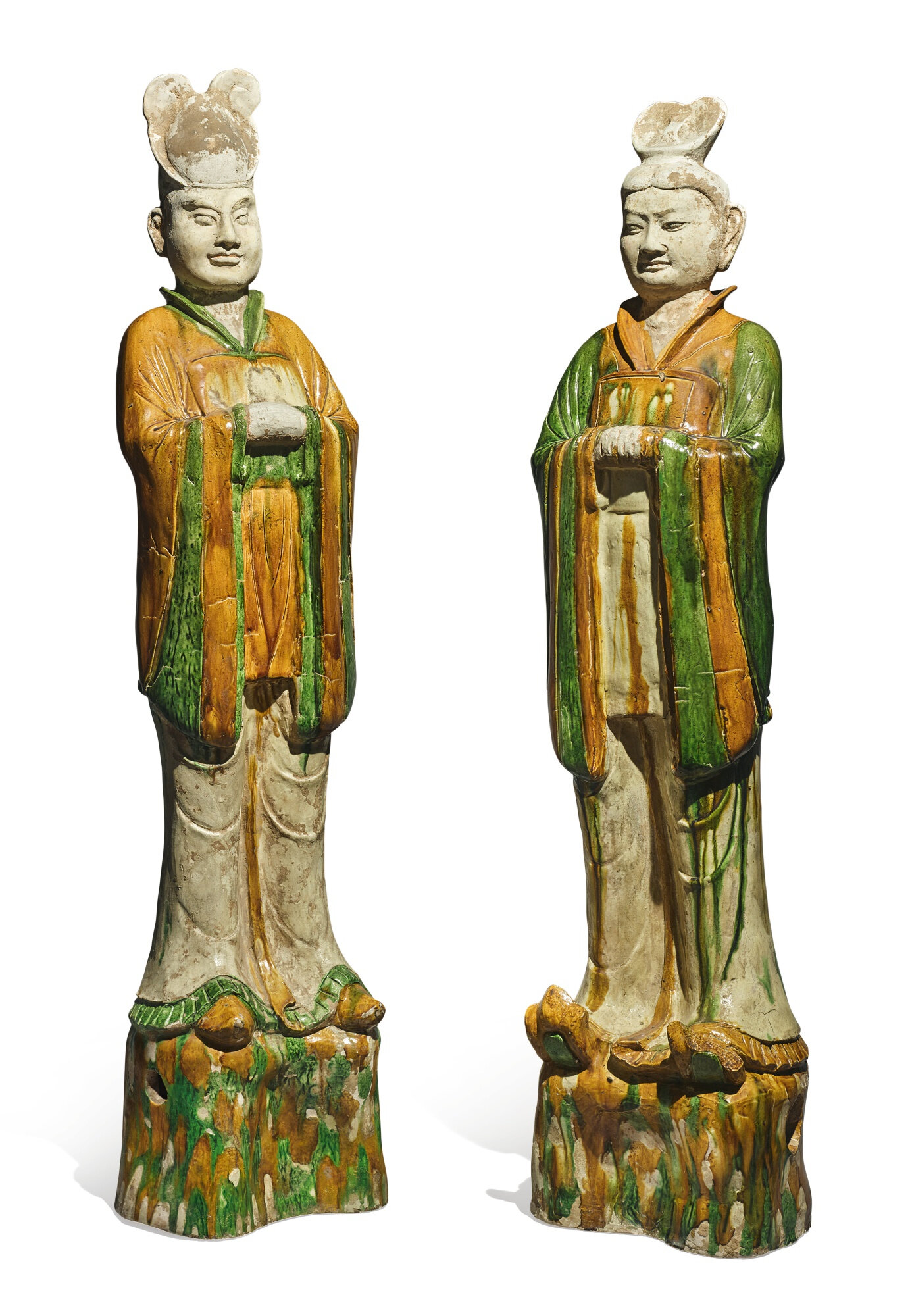 A pair of sancai-glazed pottery figures of civil officials, tang dynasty (618-907)