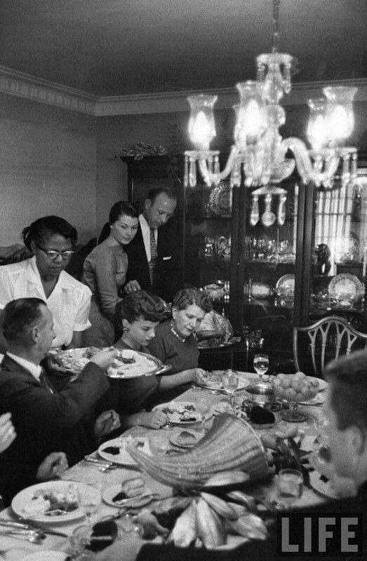 Ralph Crane - George Sutton and his family entertaining their relatives at home for Thanksgiving dinner, CA, US, 1956.