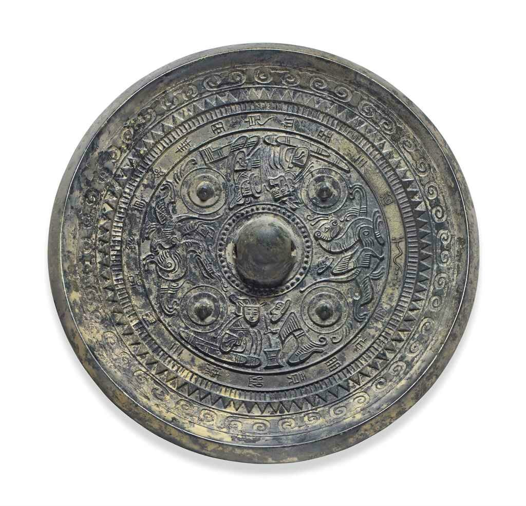 A bronze circular mirror with deities, animals and inscription, Late Eastern Han dynasty, 2nd-3rd century