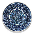 A highly important blue and white iznik pottery charger, turkey, circa 1480