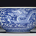 A small blue and white 'dragon' bowl, qianlong seal mark in underglaze blue and of the period (1736-1795)