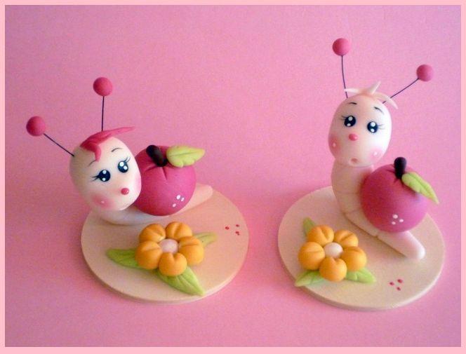 2 vers avec leur pomme sur le dos