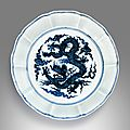 A superbly painted rare blue and white 'dragon' brush washer, Xuande mark and period (1426–1435)