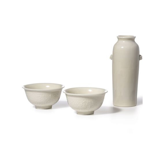 A Pair of Blanc-de-Chine Moulded Cups and a Blanc-de-Chine Sleeve Vase, Qing Dynasty, 17th-18th Century