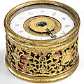 A rare beijing circular clock with gilt-metal case, qing dynasty, 18th century