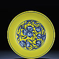 A rare large yellow-ground underglaze-blue 'peach' dish, Qianlong six-character sealmark and of the period (1736-1795)