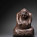 a very rare carved wood seated figure, han dynasty (206 bc-220 ad)
