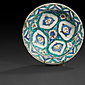 An ottoman iznik pottery dish, tabak, decorated with pomegranates, turkey, 17th century
