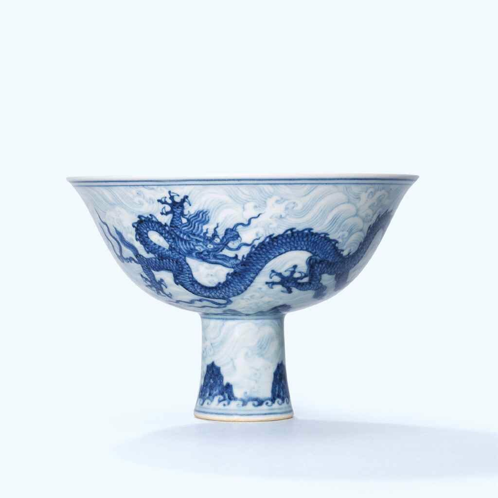 An extremely rare and superbly painted anhua-decorated blue and white 'dragon' stem bowl, Xuande six-character mark in underglaze blue within a double circle and of the period (1426-1435)