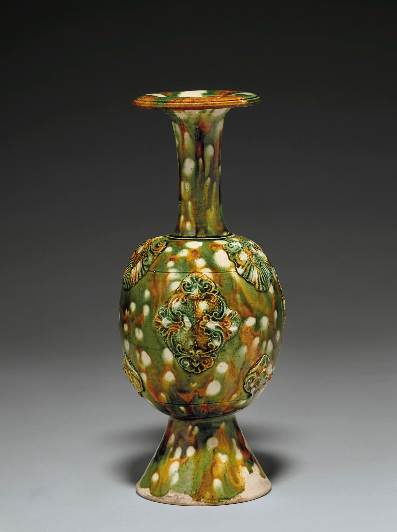 A rare sancai-glazed bottle vase, Tang dynasty (618-907)