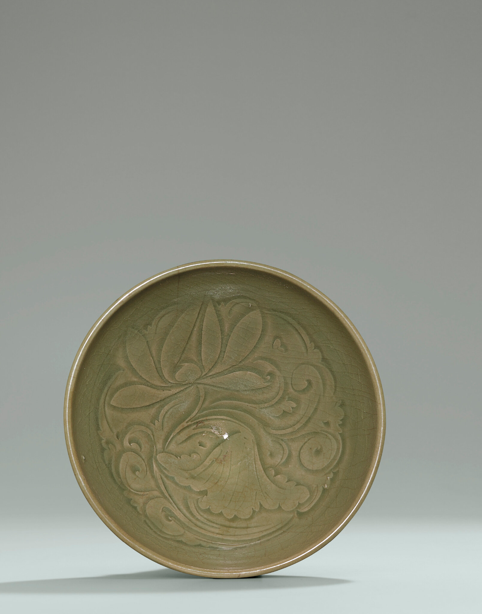 A Yaozhou carved celadon 'Lotus' bowl, Northern Song dynasty (960-1127)