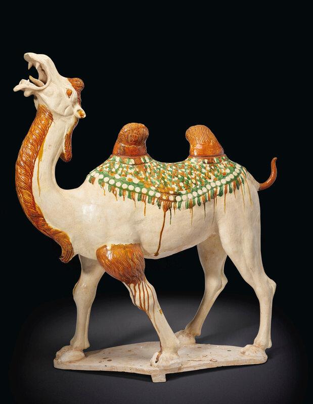 A massive sancai-glazed pottery figure of a striding Bactrian camel, Tang dynasty (AD 618-907)