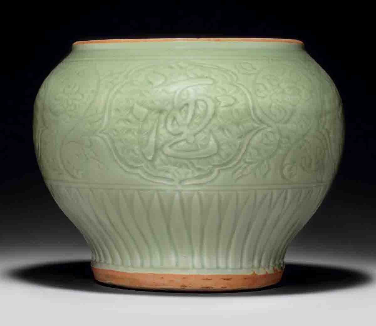 A Longquan celadon carved baluster jar,guan, early Ming dynasty, 15th century