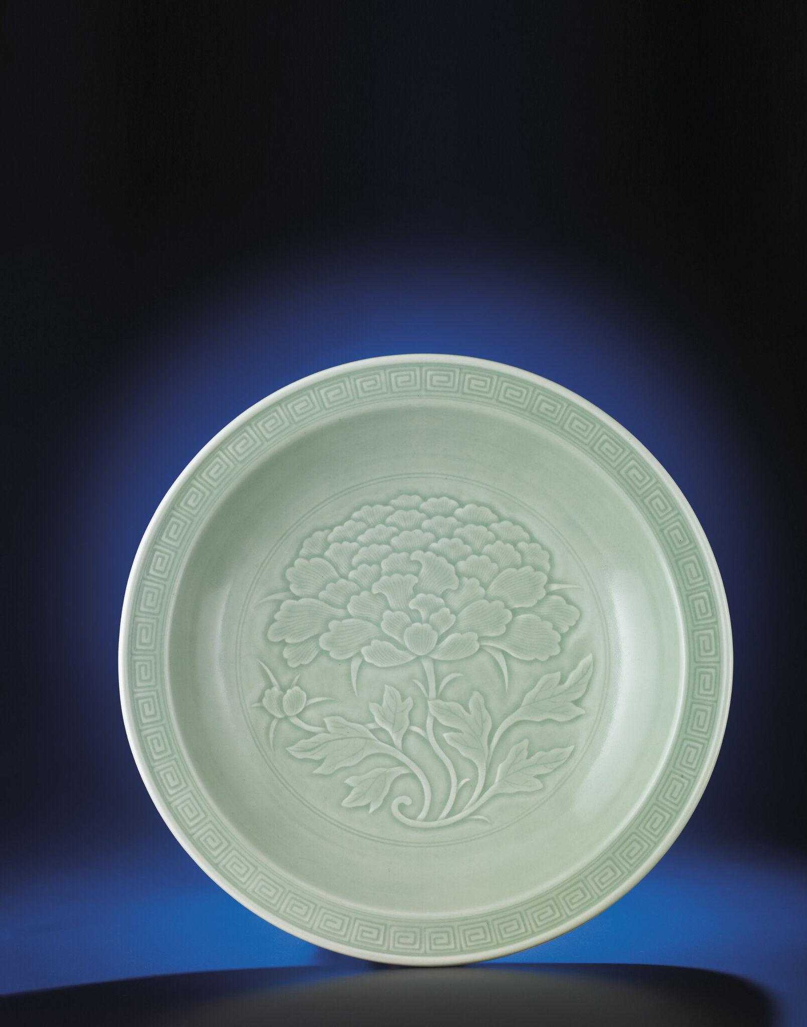 A fine and rare celadon-glazed charger, Qianlong period (1736-1795), xuhuatang zhi hall mark within double-squares