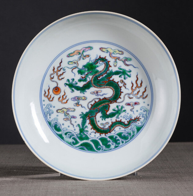A fine and rare imperial doucai Dragon dish, Yongzheng mark and period (1723-1735)