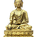 A large and rare gilt copper-alloy figure of shakyamuni buddha, tibet, circa 16th century