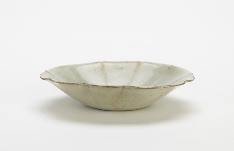 Dish with foliate rim, 11th-early 12th century, Northern Song dynasty, Porcelain with transparent pale-blue (qingbai) glaze, H: 2.3 W: 11.1 cm, China. Gift of Charles Lang Freer, F1917.310. Freer/Sackler © 2014 Smithsonian Institution