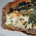 La petite fille aux allumettes et partager au coin du feu une tarte feuilletée de blé noir au gorgonzola et aux épinards