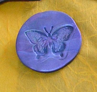 broche papillon prune