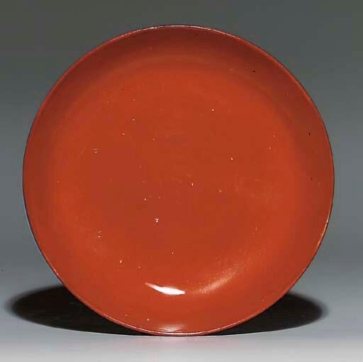 A coral-glazed dish, Wanli period (1573–1620)