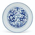 A large blue and white 'dragon' dish, jiajing six-character mark in underglaze blue in a line and of the period (1522-1566)