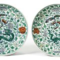 A pair of doucai 'dragon and phoenix' dishes, qing dynasty, kangxi period (1662-1722)