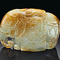 A small pale greyish-green and russet jade figure of an elephant, late ming dynasty, 17th century