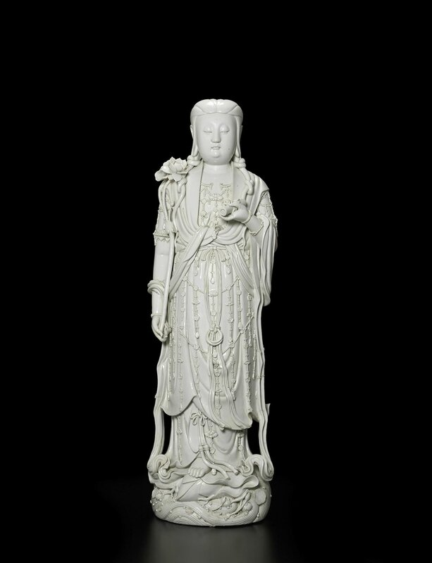 A large blanc de chine figure of Guanyin, 19th-early 20th century, two Xu Yunlin seal marks and one Dehua seal mark