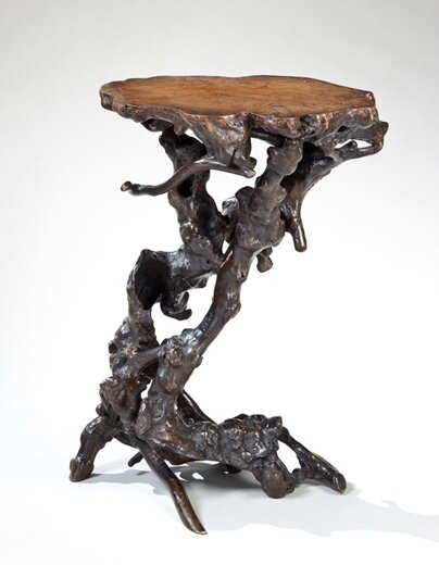 A natural elm root () stand of irregular twisting gnarled shape