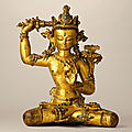A superbly cast gilt-copper stone-inlaid seated figure of manjusri, nepal, 14th century