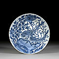 A blue and white porcelain 'phoenix and peony' dish, qing dynasty, kangxi period (1662-1722)